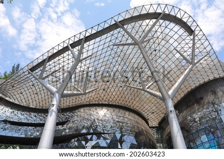 Singapore - June 10, 2014: Beautiful facade of Ion Orchard, one of famous shopping malls in Singapore. - stock photo