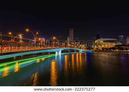 SINGAPORE - JUNE 30: Esplanade Theatres on the Bay is a waterside building at night on June 30, 2015 in Singapore.  - stock photo