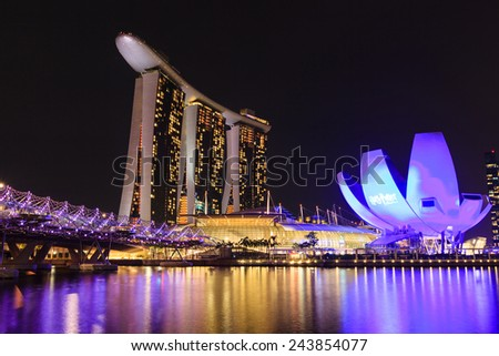 SINGAPORE - JUNE 13: Marina Bay Sands Resort Hotel and the Helix bridge on JUNE, 2013 in Singapore. The resort is one of the most expensive stand alone casino property in the world. - stock photo