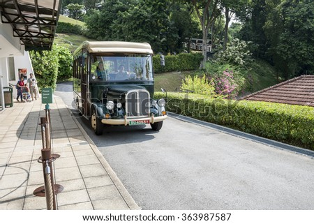 "SINGAPORE - JUNE 20, 2009: Shuttle bus of Military museum Fort Siloso - the last remaining coastal gun battery from the twelve batteries of ""Fortress Singapore"" in Sentosa island - stock photo"