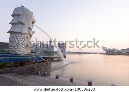 SINGAPORE - Mar, 1 - The Merlion fountain and Marina Bay with sunrise morning March 1, 2014.Merlion is a mythical creature with the head of a lion and the body of a fish,and is a symbol of Singapore. - stock photo
