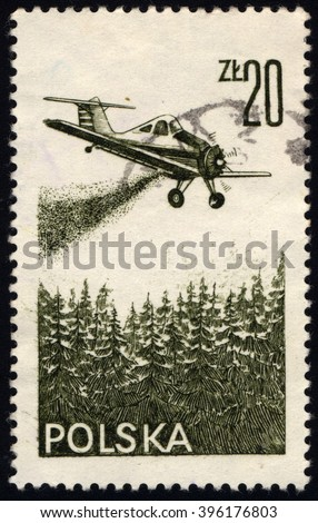 """SINGAPORE - MARCH 26, 2016: A stamp printed in Poland shows airplane PZL-106 """"Kruk"""" (Raven), wood handles pesticides, circa 1977 - stock photo"""