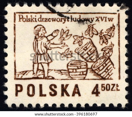 SINGAPORE - MARCH 26, 2016: A stamp printed in Poland to commemorate Polish Folklore shows Beekeeper, circa 1974 - stock photo