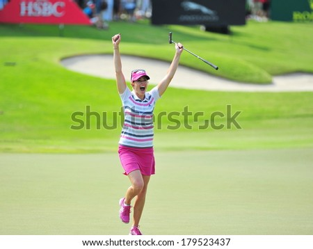 SINGAPORE - MARCH 2: American Paula Creamer overjoyed with winning the title at the HSBC Women's Champions at Sentosa Golf Club Serapong Course March 2, 2014 in Singapore - stock photo