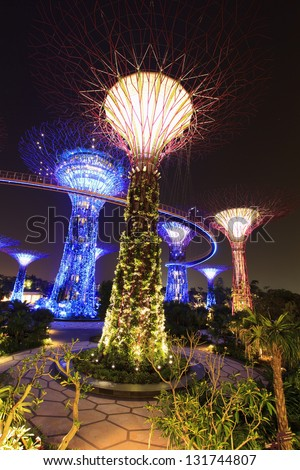 SINGAPORE  MARCH10 : Night view of The Supertree Grove at Gardens by the Bay on March 10, 2013 in Singapore. Spanning 101 hectares of reclaimed land in central Singapore, adjacent to Marina Reservoir. - stock photo
