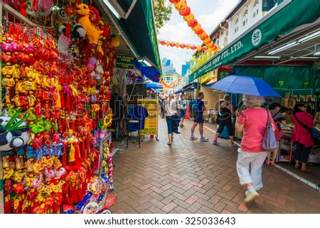 SINGAPORE - MARCH 6: Singapore's Chinatown, an ethnic neighborhood featuring Chinese cultural elements and a historically concentrated ethnic Chinese population on March 6, 2015. - stock photo