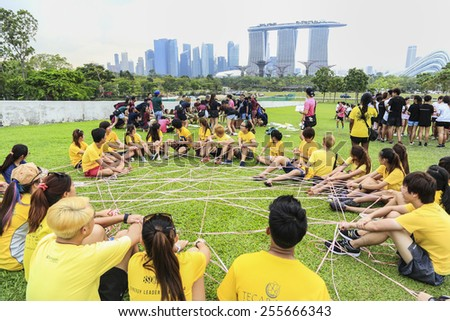 SINGAPORE - MARCH 29: Team competition kids in Singapore at Marina Bay March 29, 2014 in Singapore. - stock photo