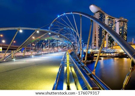 SINGAPORE - MARCH 1: The Helix Bridge is a pedestrian bridge linking Marina Centre with Marina South in the Marina Bay area of Singapore March 1, 2013 in Singapore, Singapore - stock photo