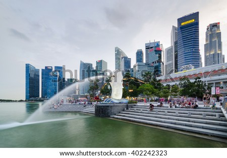 SINGAPORE - March 22, 2016: The Merlion fountain in Singapore. Merlion is a imaginary creature with the head of a lion,seen as a symbol of Singapore. - stock photo