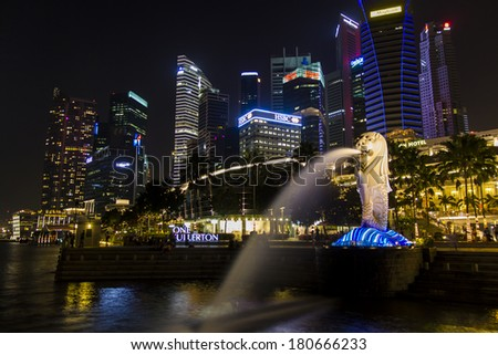 SINGAPORE -MARCH 1:The Merlion fountain lit up at night in Singapore  on March 1, 2014 in Singapore. - stock photo