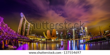 SINGAPORE - MARCH 10: World's most expensive standalone casino property at US$ 6.3 billion. Marina Bay Sands Hotel dominates the skyline at Marina Bay March 10, 2013 in Singapore. - stock photo