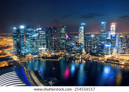 Singapore Marina Bay rooftop view with urban skyscrapers.   - stock photo