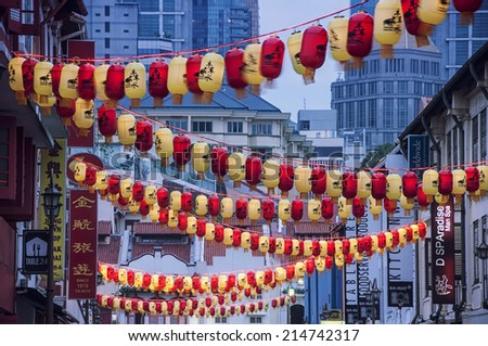 SINGAPORE - MAY 18, 2014: Chinatown with notable chinese buildings, restaurants and decoration. Many tourists find there authentic food, clothes and other stuff - stock photo