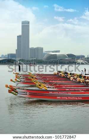 SINGAPORE - MAY 5: Dragon Boats at the dock in Singapore's first international dragon boat race at Marina Bay, Singapore on May 5, 2012. - stock photo