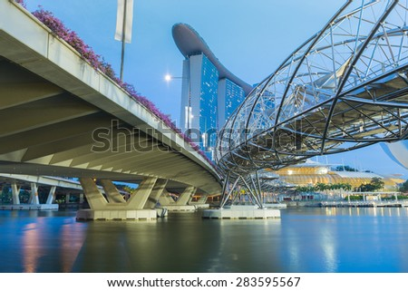 SINGAPORE, MAY 23: Helix Bridge across to Marina Bay Sands during twilight time, famous touristic attractions of Singapore, on May 23, 2015 in Singapore - stock photo