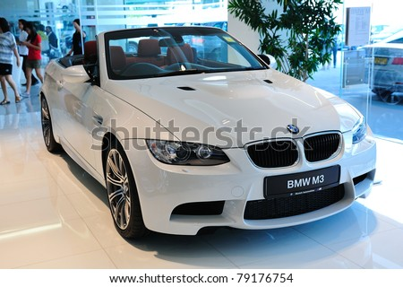 SINGAPORE - MAY 21: Static display of BMW M3 Cabriolet at Munich Automobiles BMW Service Centre Open House on May 21, 2011 in Singapore - stock photo