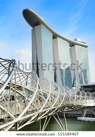 SINGAPORE - May 03, 2013: The Helix Bridge and Marina Bay Sands in Singapore, Republic of Singapore, May 3, 2013. The Helix is fabricated from 650 tonnes of Duplex Stainless Steel and 1000 tonnes of carbon steel. - stock photo