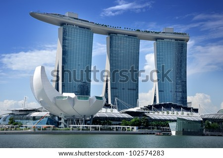 SINGAPORE-MAY 9: The Marina Bay Sands Resort Hotel on May 9, 2012 in Singapore. It is an integrated resort and the world's most expensive standalone casino property at S$8 billion. - stock photo