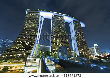 SINGAPORE - NOV 01 : The 6.3 billion dollar (US) Marina Bay Sands Hotel dominates the skyline at Marina Bay on Nov 01, 2012 in Singapore. - stock photo