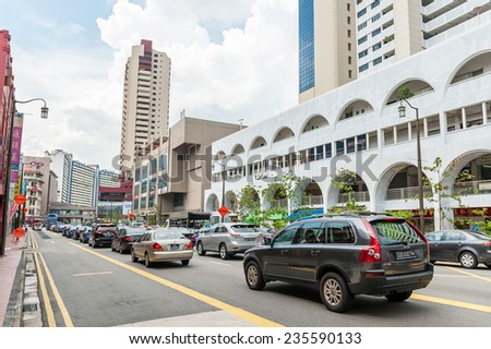 SINGAPORE - NOV, 24, 2014: The traffic in Singapore. The government spend SGP$14 billion to improve Singapore's road infrastructure over the coming years. - stock photo