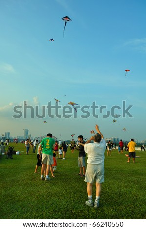 SINGAPORE - NOVEMBER 21: Kite festival, a gathering for kite enthusiast at Marina Barrage November 21, 2010 in Singapore. - stock photo