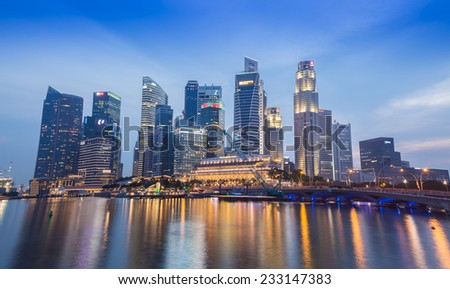 SINGAPORE-NOVEMBER 01: The Singapore skyline in twilight time on November 01,2014. Singapore is the 14th largest exporter and the 15th largest importer in the world  - stock photo