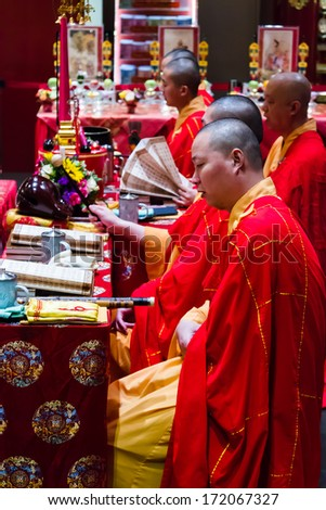SINGAPORE - NOVEMBER 14 : Unidentified Buddhism people have a ritual by pray and sing in the Buddha Relic Tooth Temple on November 14, 2013 in Singapore - stock photo