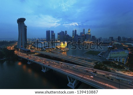 SINGAPORE - 1 Oct: The Singapore skyline shines. Singapore has a highly developed market-based economy and is a center for commerce in Asia. - stock photo