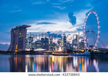 SINGAPORE - OCTOBER 16, 2014: Marina Bay Sands, Singapore Flyer and ArtScience Museum at sunset. - stock photo