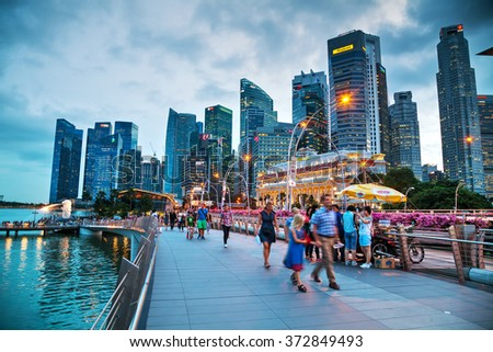 SINGAPORE - OCTOBER 30: Overview of the marina bay with the Merlion on October 30, 2015 in Singapore. - stock photo
