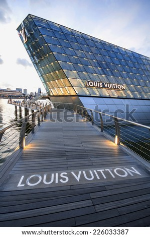 SINGAPORE - OCTOBER 14: The futuristic building housing Louis Vuitton store with amazing sky,OCTOBER 14, 2014 in Singapore. - stock photo