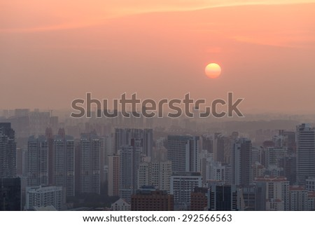 Singapore rooftop view of Marina Bay with urban skyscrapers at sunset. - stock photo