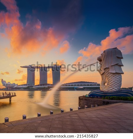 SINGAPORE-SEP 01: The Merlion fountain in front of the Marina Bay Sands hotel on September 01, 2014 in Singapore. Merlion is a imaginary creature with the head of a lion,seen as a symbol of Singapore  - stock photo