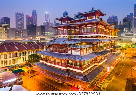 SINGAPORE - SEPEMBER 9, 2015: Buddha Tooth Relic Temple at twilight. The temple is based on Tang dynasty architecture and built to house the tooth relic of Buddha.  - stock photo