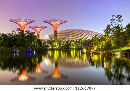 SINGAPORE - SEPT 07: Night view of Supertree Grove at Gardens by the Bay on Sept 07, 2012 in Singapore. Spanning 101 hectares of reclaimed land in central Singapore, adjacent to the Marina Reservoir. - stock photo