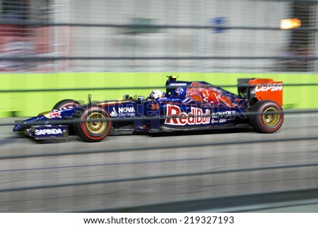 SINGAPORE - SEPTEMBER 20. Daniil Kyvat of Russia in Toro Rosso Renault took up 10th place in the Grand Prix Formula1 Singapore 20th SEPT 2014 - stock photo