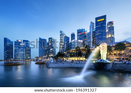 SINGAPORE, SINGAPORE - APRIL 10, 2014: Merlion in Singapore.Tourist gathering at the Merlion in Singapore on April 10.  Merlion is a central gathering spot for tourists in Singapore.  - stock photo