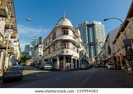Singapore, Singapore - Aug 30: Singapore heritage buildings in Chinatown against the new skyscraper as backdrop taken on August 30, 2013  - stock photo