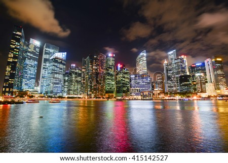 SINGAPORE, SINGAPORE - JANUARY 18, 2015 - landscape of the city-state Singapore asia with views of skyscrapers and Marina Bay Sands, which houses the swimming pool the world's highest - stock photo