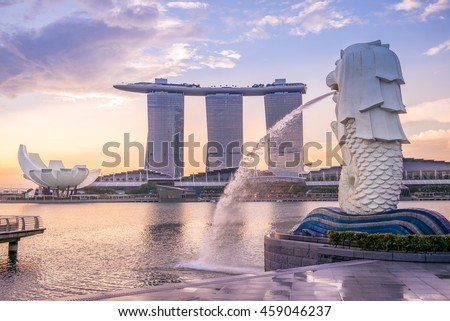 Singapore, Singapore - May 21, 2016: silhouette of Merlion Statue at Marina Bay against the sunrise. Merlion is a well known marketing icon of Singapore depicted. - stock photo