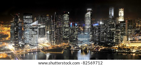 Singapore Skyline at Night from Marina Bay Sands resort - stock photo