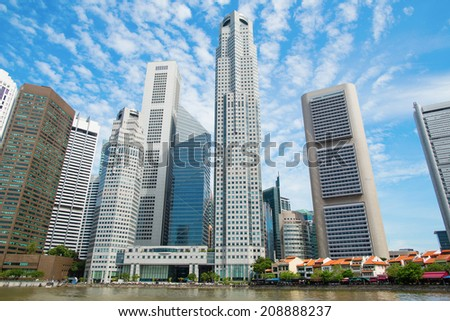 Singapore skyline seen from the Singapore river - stock photo