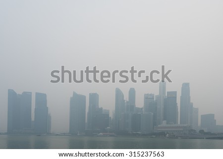 Singapore - 10th September, 2015: Haze fills the downtown area. Haze is caused by the forest fire and burning of plantation in Indonesia. - stock photo