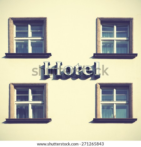 Singboard of hotel. Instagram style filtred image.  - stock photo