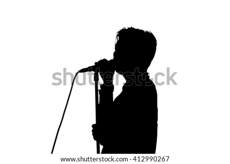 Singer in silhouette - stock photo