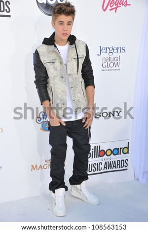 Singer Justin Bieber arrives at the 2012 Billboard Music Awards held at the MGM Grand Garden Arena. - stock photo