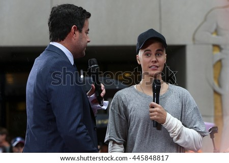Singer Justin Bieber (R) and Carson Daly on NBC's 'TODAY Show' at Rockefeller Plaza on September 10, 2015 in New York City. - stock photo