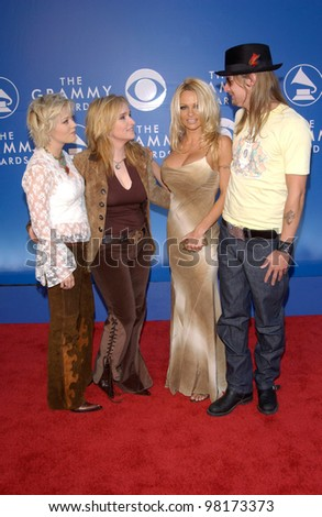 Singer MELISSA ETHERIDGE & partner TAMMIE LYNN MICHAELS (left) with singer KID ROCK & girlfriend actress PAMELA ANDERSON at the 2002 Grammy Awards in Los Angeles. - stock photo