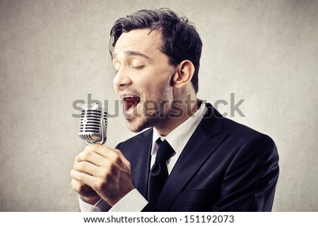 singer singing to the microphone - stock photo