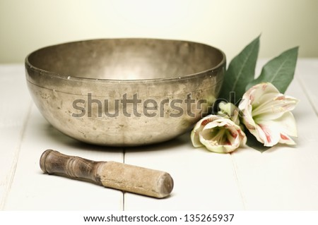 singing bowl on a white table, selective focus - stock photo